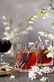 A Bourbon cocktail featuring Amaro served over ice with dark coktail cherries garnish