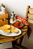 Pastel de Nata Fresh baked Portuguese egg custard Tart and Coffee on wooden table in Cafe
