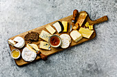 Different types of cheese Snack assortment on wood serving cheese board