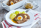 Meat loaf with poiled egg