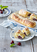 Cherry strudel with poppy seed and custard