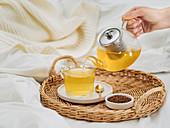 Buckwheat tea or kuqiaocha Healthy soba tea in glass cup, and glass teapot
