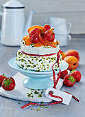 Mini birthday cake with apricots and strawberries