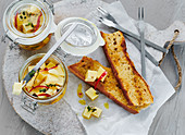 Pickled cheese served with freshly toasted bread