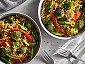 Broccoli and paprika stir-fry tossed with chickpea pasta