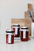 Strawberry jam in jars with DIY labels
