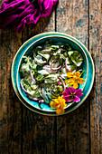 Indian Cucumber Yogurt Sauce (raita) with edible flowers