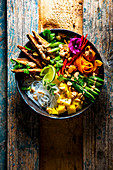 Asian vegetable glass noodle salad with mango