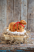 Lamb shaped yeast dough with raisins for Easter