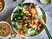 Thai Rice noodles with cucumber, carrots, and peanut sauce