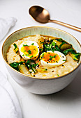 Breakfast bowl congee with vegetables and egg
