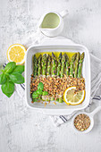 Baked asparagus with Parmesan cheese and nuts