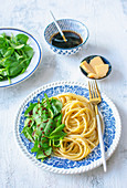 Cacio e pepe pasta with spinach and balsamic sauce