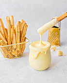 Cheese sauce as dip for Grissini