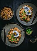 Fried rice with smoked tofu mushrooms, kimchi and fried egg