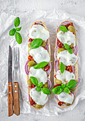 Sandwiches with mozzarella, olives, onions and sundried tomatoes