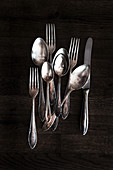 Tarnished silver cutlery - table knives, forks and spoons