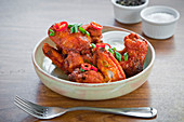 Crispy, spicy chicken wings with chilli and spring onion and yogurt dip