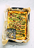 Puff pastry tart with green asparagus and bacon