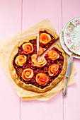 Raspberry and apple tart with pistachios and apple roses