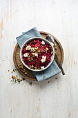 Beetroot risotto with goat cheese, thyme, and honey