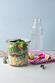 Vegetarian Asian vegetables with noodles in a jar 'To Go'