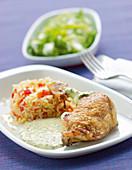 Chicken legs with garden herb hollandaise sauce and rice