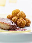 Rump steak in pepper sauce with crispy almond balls