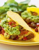 Tacos al pastor with pork, pineapple salsa, and guacamole