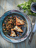 Fried turbot with sauteed greens, noodles, peanuts, and soy sauce
