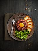 Steak tartare with egg and crostini