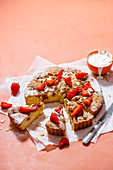 Almond sponge with strawberries and crumble topping