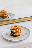 Fluffy banana pancakes with oranges and almonds
