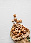 Fresh button mushrooms in a paper bag