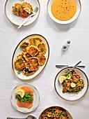 Corn cakes, salmon, lentil soup, and tabbouleh