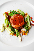 braised lamb with glazed spring onions