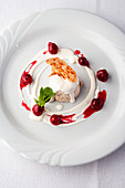 Cherry cream with vanilla cream, cherries, and mint