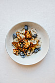 Millet porridge with blueberries, caramelized pears and walnuts