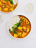 Potato and coconut stew with rice