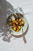 Potato salad with fried fish