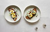 Crispy sourdough bread with boiled eggs and herb yogurt