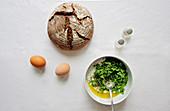 Herbal yogurt, eggs and fresh sourdough bread