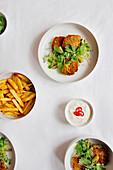 Salmon patties with lemon yogurt and french fries