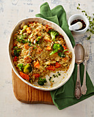 Gratinated quinoa with sausage, broccoli and cheese