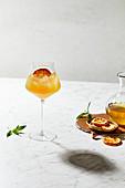 Kombucha gin orange cocktail