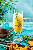 Pineapple drink with rosemrry, mango juice, lemon juice and cider