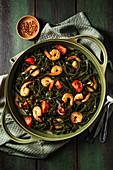 Spirulina tagliatelle pasta with prawns tomatoes and chilli flakes