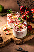 Strawberry dessert with greek yoghurt, lime zest and rosemary