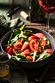 Tomato and strawberry salad with lamb's lettuce, basil, honey and olive oil dressing