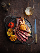 Grilled beef steak with roast potatoes and tomatoes